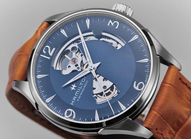 Herrenuhr Hamilton Jazzmaster Open Heart H-10 42mm mit blauem Zifferblatt und Armband aus Kalbsleder mit Krokodilprägung bei Brogle