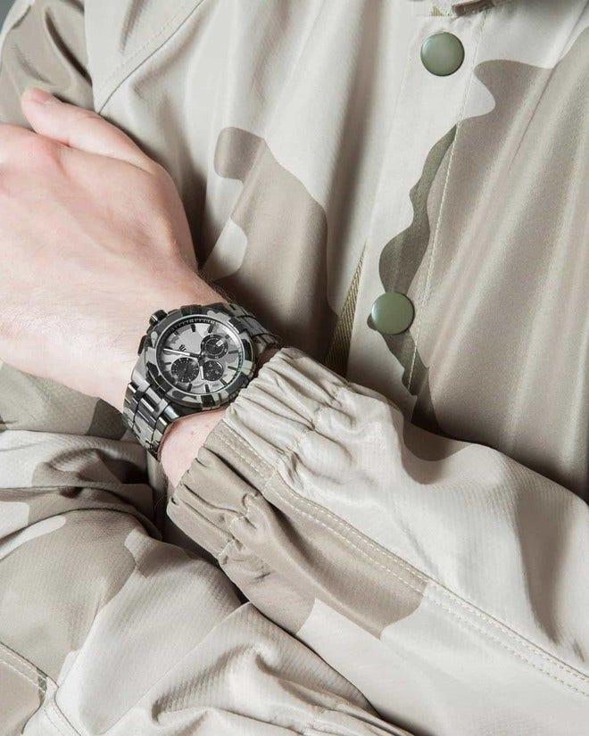 Herrenuhr Maurice Lacroix Camouflage Limited Edition mit mehrfarbigem Zifferblatt und Edelstahlarmband bei Brogle