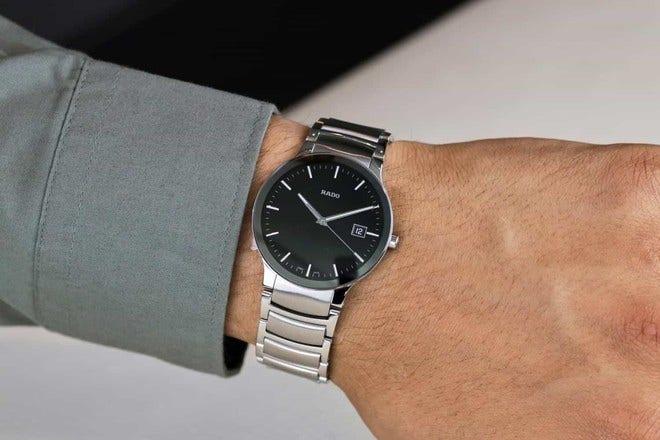 Armbanduhr Rado Centrix L Quarz mit schwarzem Zifferblatt und Edelstahlarmband bei Brogle