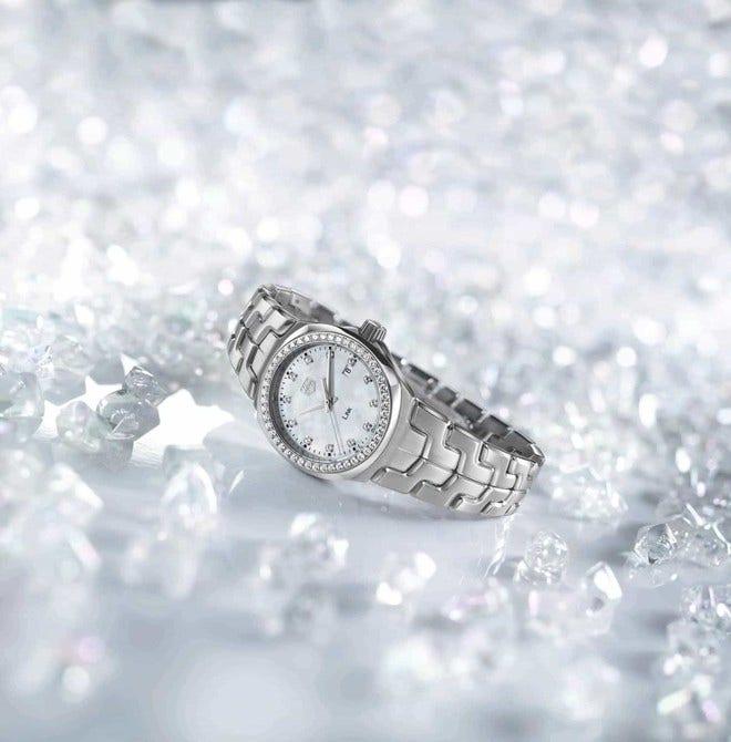 Damenuhr TAG Heuer Link Quartz 32mm mit Diamanten, weißem Zifferblatt und Edelstahlarmband bei Brogle