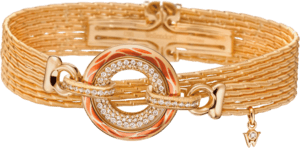 Armband mit Anhänger Wellendorff Wahres Glück Koralle aus 750 Gelbgold und Wellendorff-Kaltemaille mit mehreren Brillanten (0,85 Karat)